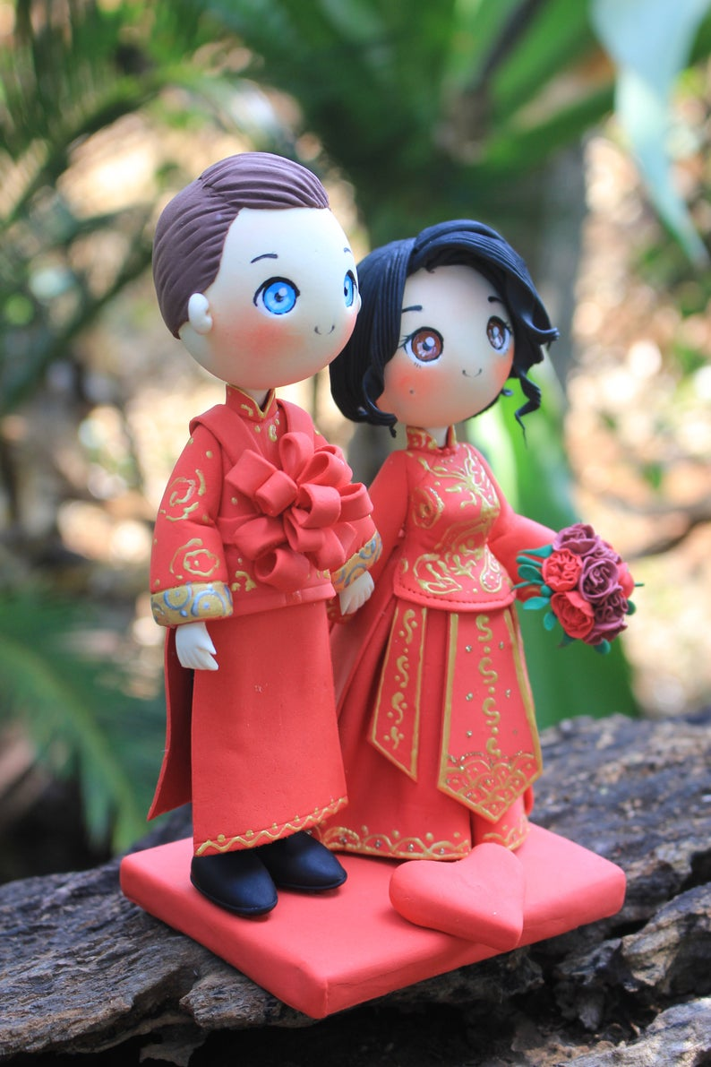 Picture of Chinese wedding cake topper, Chinese traditional wedding dress clay miniature
